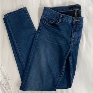 J Brand Mid Rise Skinny Jean with cuts Size 28